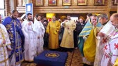 司祭 : CHERKASY REGION, UKRAINE, OCTOBER 10, 2019: priests pray, church ceremony, consecration rite of newly built Church by Metropolitan Epiphany, head of united local Ukrainian Orthodox Church