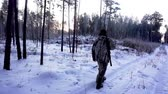 погоня : Hunters in the Woods. Armed Rangers in winter forest