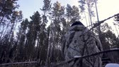 silahlı : Hunters in the Woods. Armed Rangers in winter forest