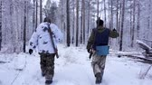 gyalogság : Two Hunters in the Woods. Armed Rangers in winter forest