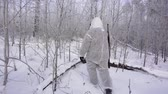 tacticas : Hunters in the Woods. Armed Rangers in winter forest