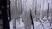 corps : Hunters in the Woods. Armed Rangers in winter forest