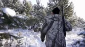 förster : Hunters in the Woods. Armed Rangers in winter forest