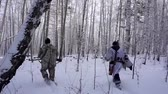 погоня : Two Hunters in the Woods. Armed Rangers in winter forest