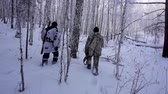 corps : Two Hunters in the Woods. Armed Rangers in winter forest