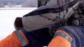 fresh caught : Fisherman catches a fish under ice. Ice fishing Stock Footage