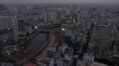 Aerial view of the Ben Nghe River, city skyline and traffic on the streets of Ho Chi Minh City, Vietnam Stock mozgókép