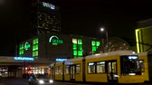 TRAFFIC, TRAMS AND PEOPLE, KARL LIEBKNECHT STRASSE, BERLIN, GERMANY – 15 FEBRUARY 2018: Trams, people and traffic near Alexanderplatz Station nighttime, Berlin, Germany