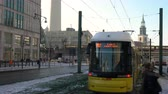 TRAMS AND TRAFFIC ON KARL LIEBKNECHT STRASSE, BERLIN, GERMANY – 13 FEBRUARY 2018: 4K video of traffic, people and trams on Karl-Liebknecht-Strasse by Alexanderplatz Train Station, Berlin, Germany