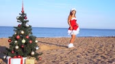 senhora : girl in costume on the new resort on the beach with gifts 1