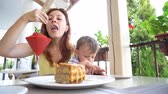 four children : mother and young son are eating in the restaurant Stock Footage