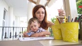 individual : mom with son use a smartphone for Internet Stock Footage