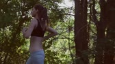 trees : brunette girl is running through the Woods Stock Footage