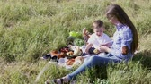 rodzeństwo : mom son eat at a picnic in the forest 1 Wideo