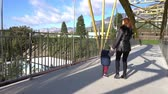 ringhiere : mom and little son go over the bridge