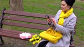 Cheerful brunette woman enjoying smell of yellow tulips given by beloved man Dostupné videozáznamy