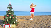 colagem : Woman on the beach with christmas tree and gifts