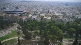 akropol : Rooftops and houses in Athens, Greece. Stok Video