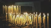 連帯 : Burning candles on altar in church.