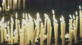 simbolismo : Burning candles on altar in church.