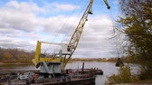 cair : River crane shifts the silt to the shore on the Oka river near Ryazan