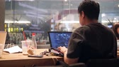 cápsulas : Cyber Sports Gamer Playing Online Game on Portable Computer in Cafe. 4K. Bangkok, Thailand - OCT 26 2017. Stock Footage