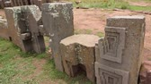 columbian : Row of megalithic stones with intricate carving in the complex Puma Punku