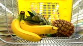 cart n corrugado : The cart in a supermarket. Bananas and pineapple are put in the cart. Stock Footage