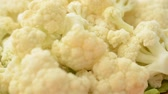 single broccoli : Cauliflower on a board. Stock Footage