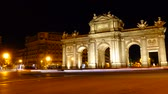 triumphal arch : The Puerta de Alcala. Time lapse. Alcala Gate is a Neo-classical monument in the Plaza de la Independencia in Madrid.