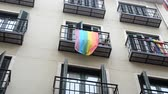 social event : Rainbow flag (LGBT movement) on balconies in Madrid, Spain.