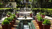 flowerpot : The fountain in the yard of the house-museum of Sorolla. Slow motion.