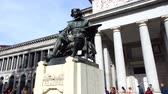 main line : MADRID, SPAIN - APRIL 05, 2018: The bronze statue of Diego Velazquez. Unknown people near Prado Museum.