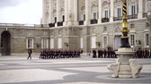 gyalogosok : MADRID, SPAIN - APRIL 04, 2018: The ceremony of the Solemn Changing of the Guard at the Royal Palace of Madrid. That is famous event was performed on the first Wednesday of each month.