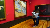 экспонат : MADRID, SPAIN - MARCH 27, 2018: Unknown visitors take pictures of the house-museum of Sorolla. Joaqu