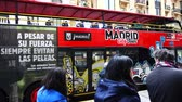 open air museum : MADRID, SPAIN - APRIL 04, 2018: Unknown people on Gran Via Street. The tourist bus lands tourists. Stock Footage