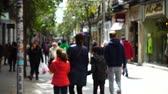 madryt : Out of focus. The people on the streets of Madrid. Movement of people along Fuencarral street. Slow motion.
