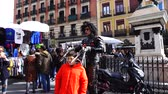 e commerce : MADRID, SPAIN - MARCH 25, 2018: Unknown actors Edward Scissorhands entertain public in the El Rastro market.