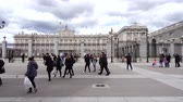 realeza : MADRID, SPAIN - MARCH 27, 2018: Unknown tourists about the royal palace. The royal palace of the greatest of all the royal palaces of Europe.