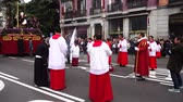 brotherhood : MADRID, SPAIN - MARCH 25, 2018: The celebrations of the Holy Week in Madrid, began at the Cathedral of La Almudena with the solemn Mass of the Palm Trees, with the blessing of the palms and the bouquets.
