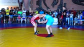 struggling : BERDYANSK, UKRAINE - JUNE 12, 2018: First open all-Ukrainian freestyle wrestling tournament in honor of the master of sports of the international class Vladimir Fedorenko. Stock Footage