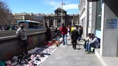 triumphal arch : MADRID, SPAIN - APRIL 3, 2018: Illegal trade on streets. The Puerta de Alcala. Alcala Gate is a Neo-classical monument in the Plaza de la Independencia.