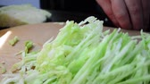 chef quipe : The cook cuts cabbage Stock Footage