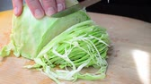 part culas : The cook cuts cabbage Stock Footage