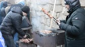 сувениры : LVIV, UKRAINE - DECEMBER 10, 2015: Celebration of Christmas. Shish kebabs on a brazier. Preparation of meat.