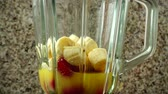 glass jugs : Blender from strawberry, bananas and orange juice. Stock Footage