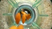 glass jugs : Falling of almonds in a blender bowl. Slow motion. Top view.