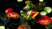 bazylia : Falling of the cut vegetables. Slow motion.