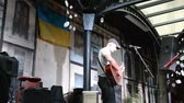 objem : LVIV, UKRAINE - JULY 5, 2014: The scene and the musician, sings songs.