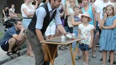 tailcoat : LVIV, UKRAINE - JULY 5, 2014: The street conjurer.